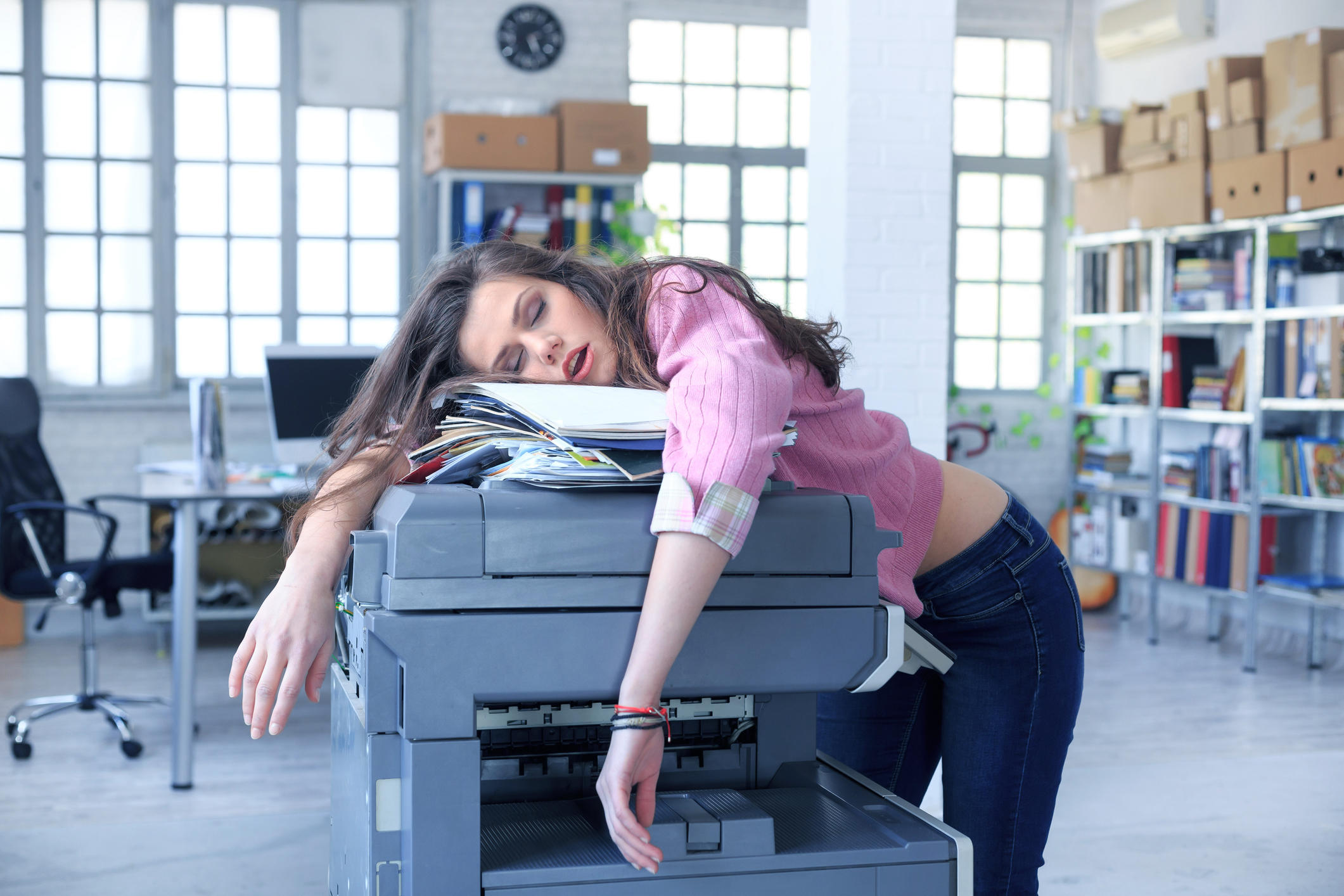 Tired assistant on copy machine
