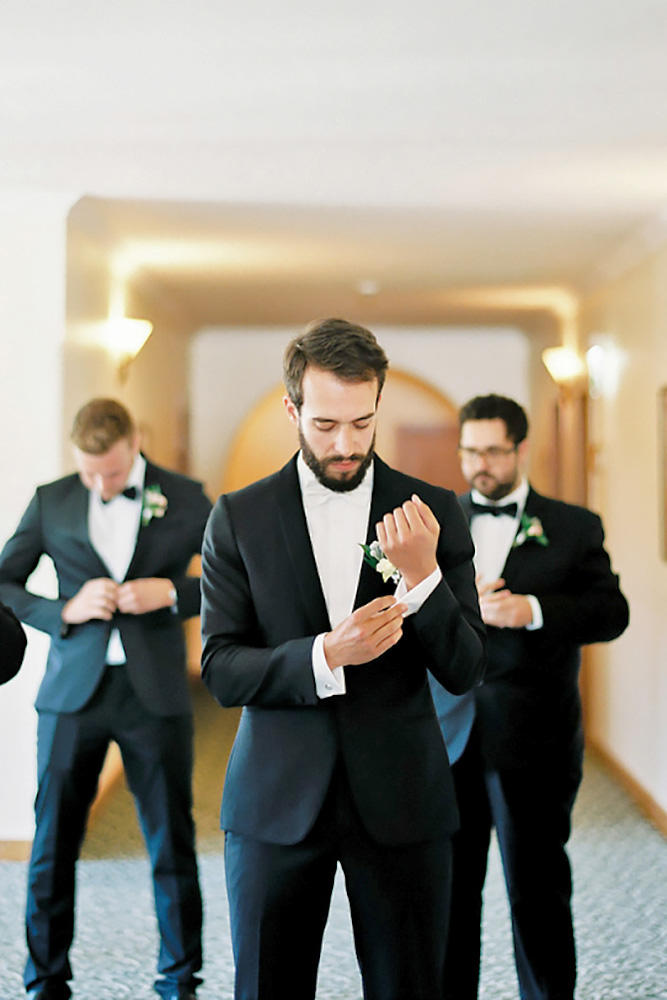 Groom fixing his cuffs