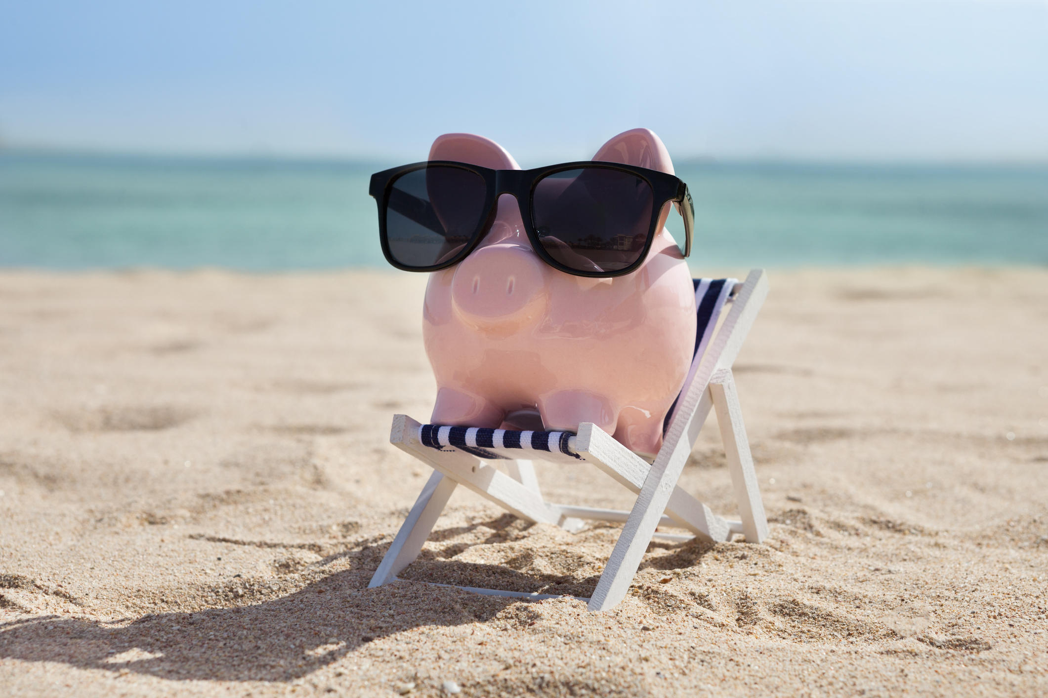 piggy bank on a beach