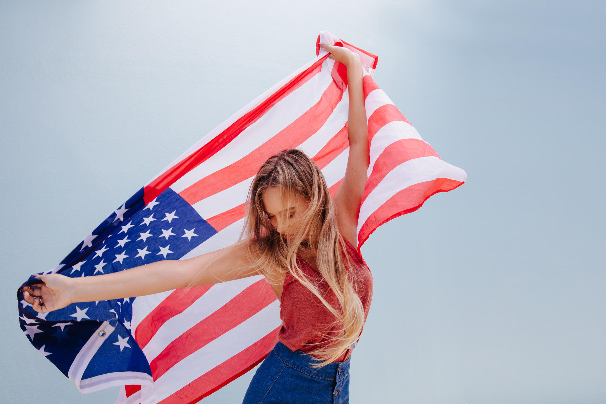 Beautiful Young Hipster Woman with USA Flag