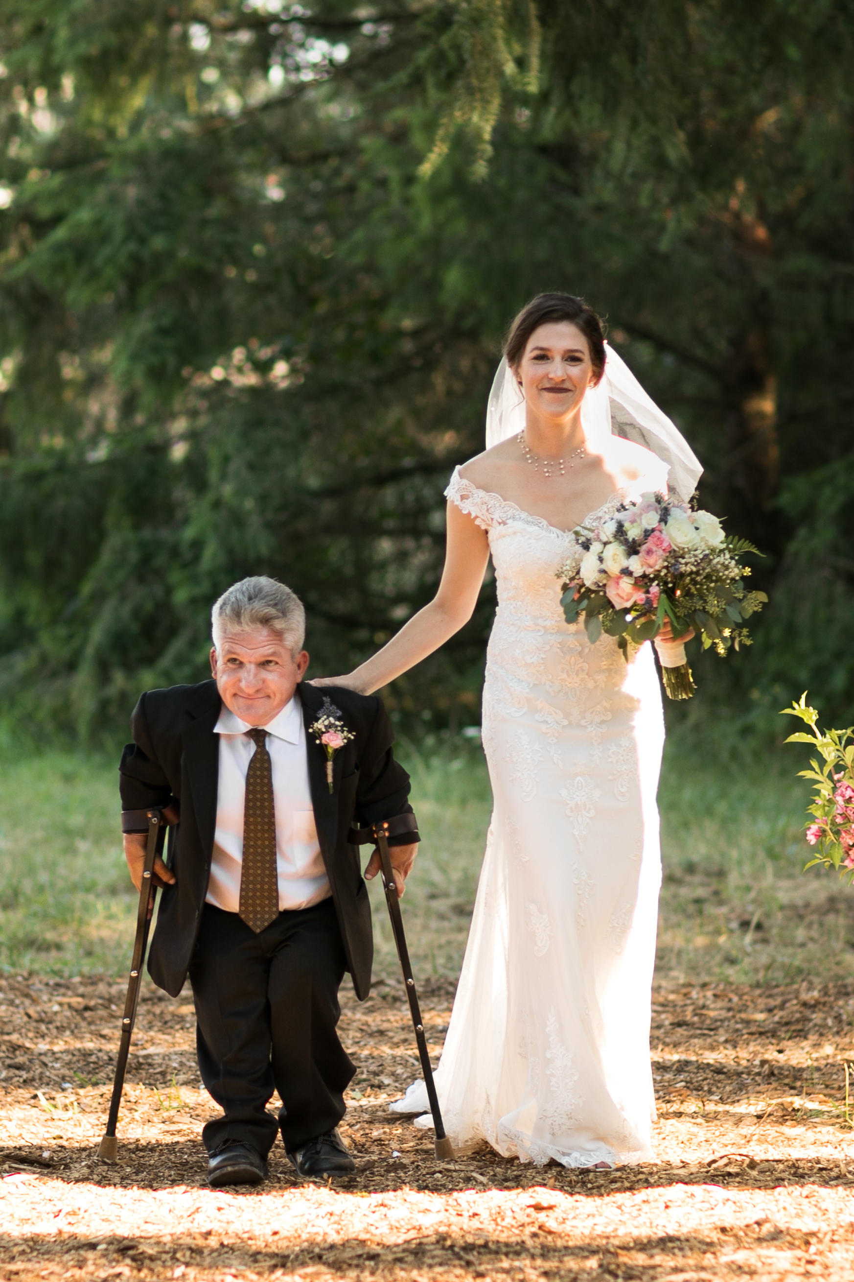 All the details from molly roloffs intimate wedding at roloff farms matt walking molly down the aisle junglespirit Choice Image