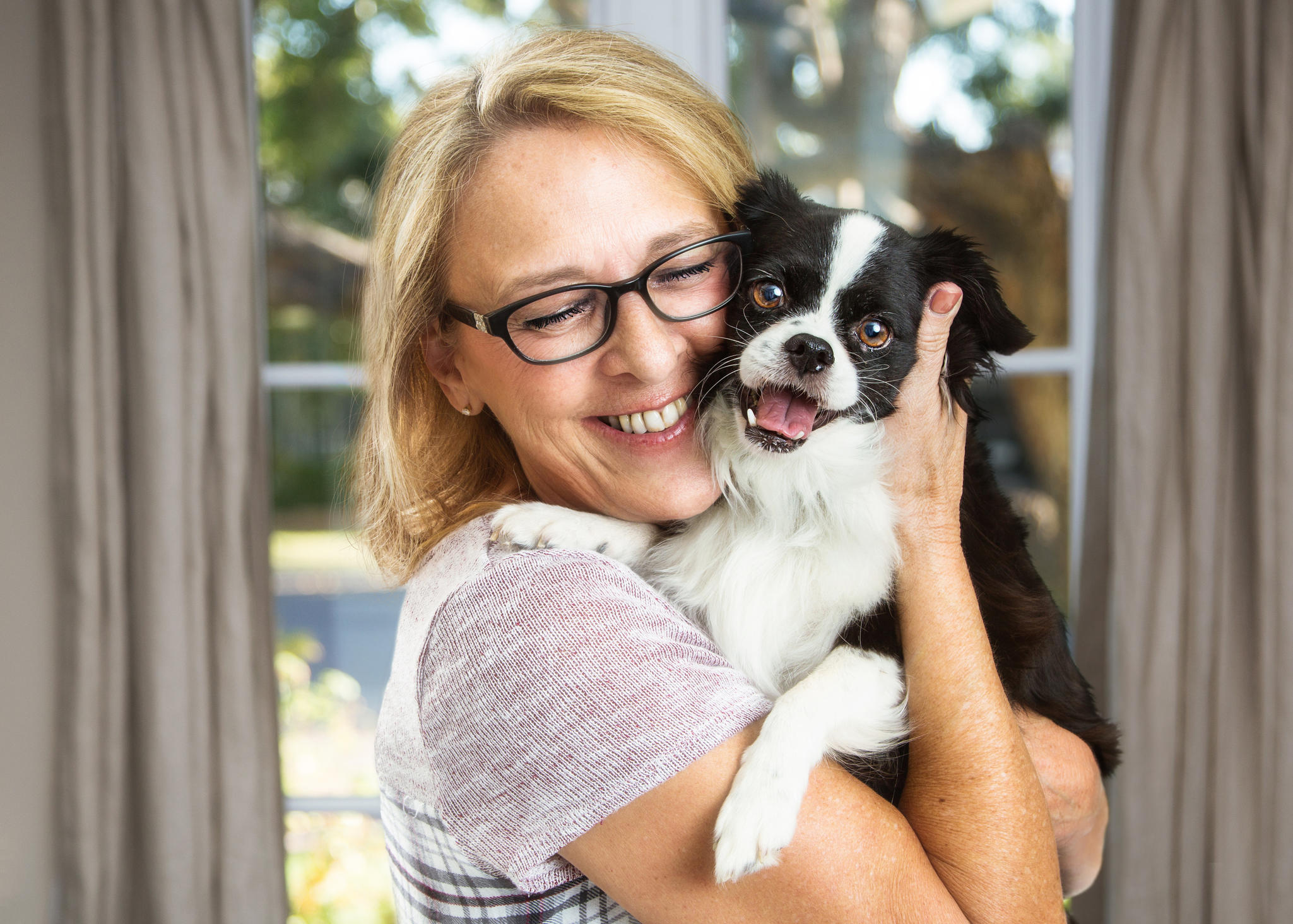 Woman happily with dog