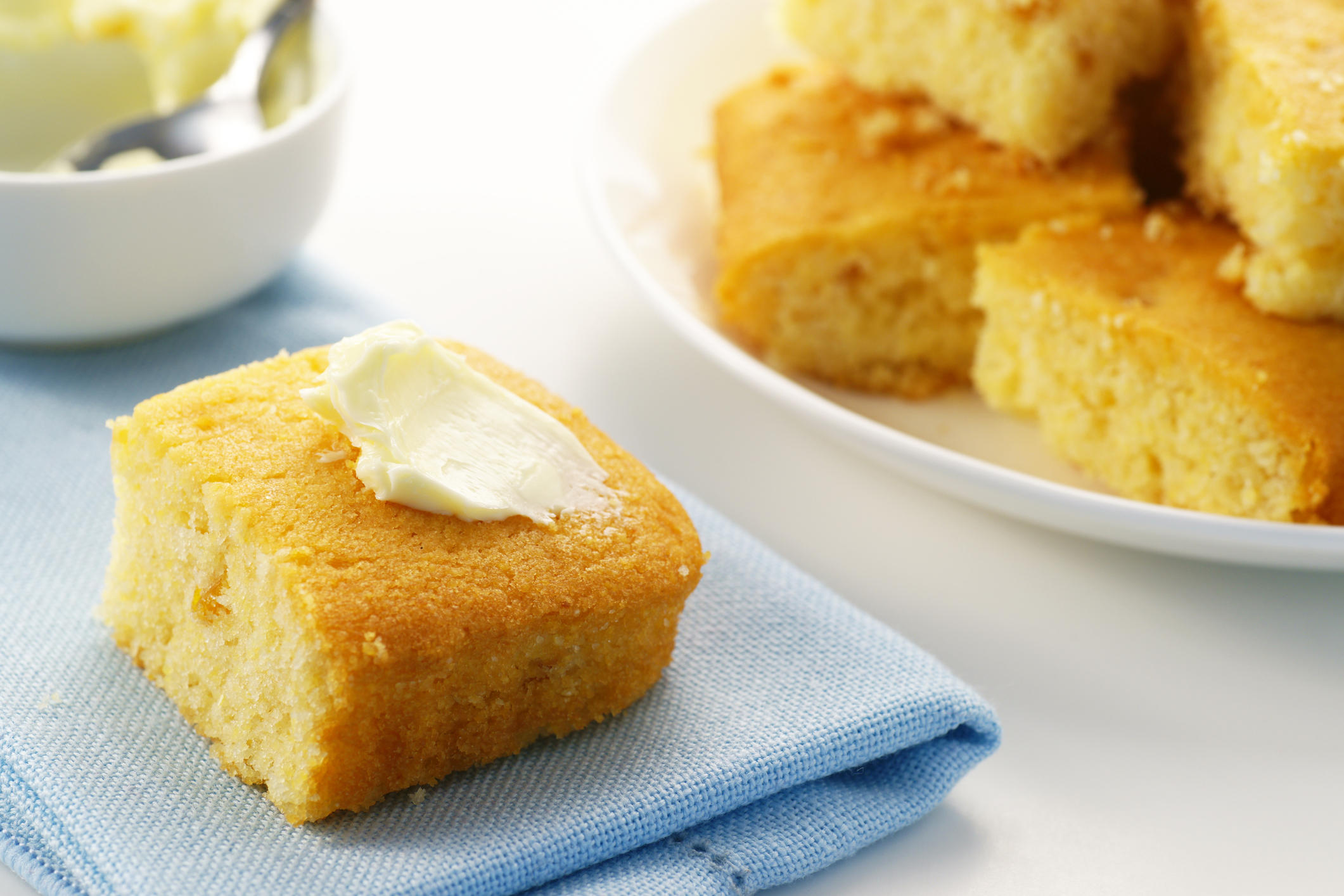 Freshly baked cornbread with sweet creamery butter.  Mmmmmm...