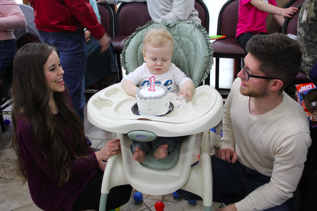 Jessa and Ben Seewald and their son Henry with his first birthday cake