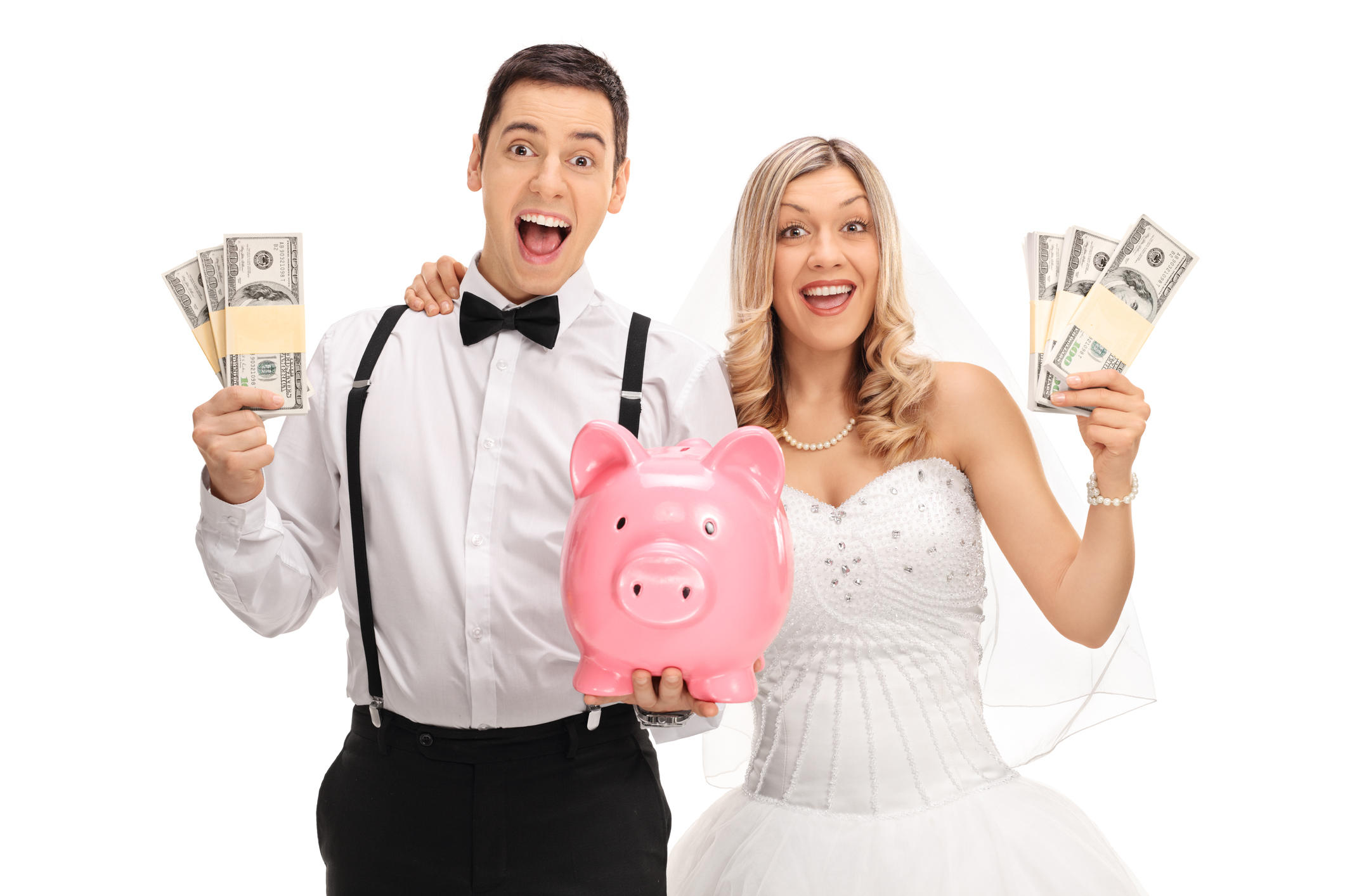 Happy newlywed couple with a piggybank and money bundles isolated on white background