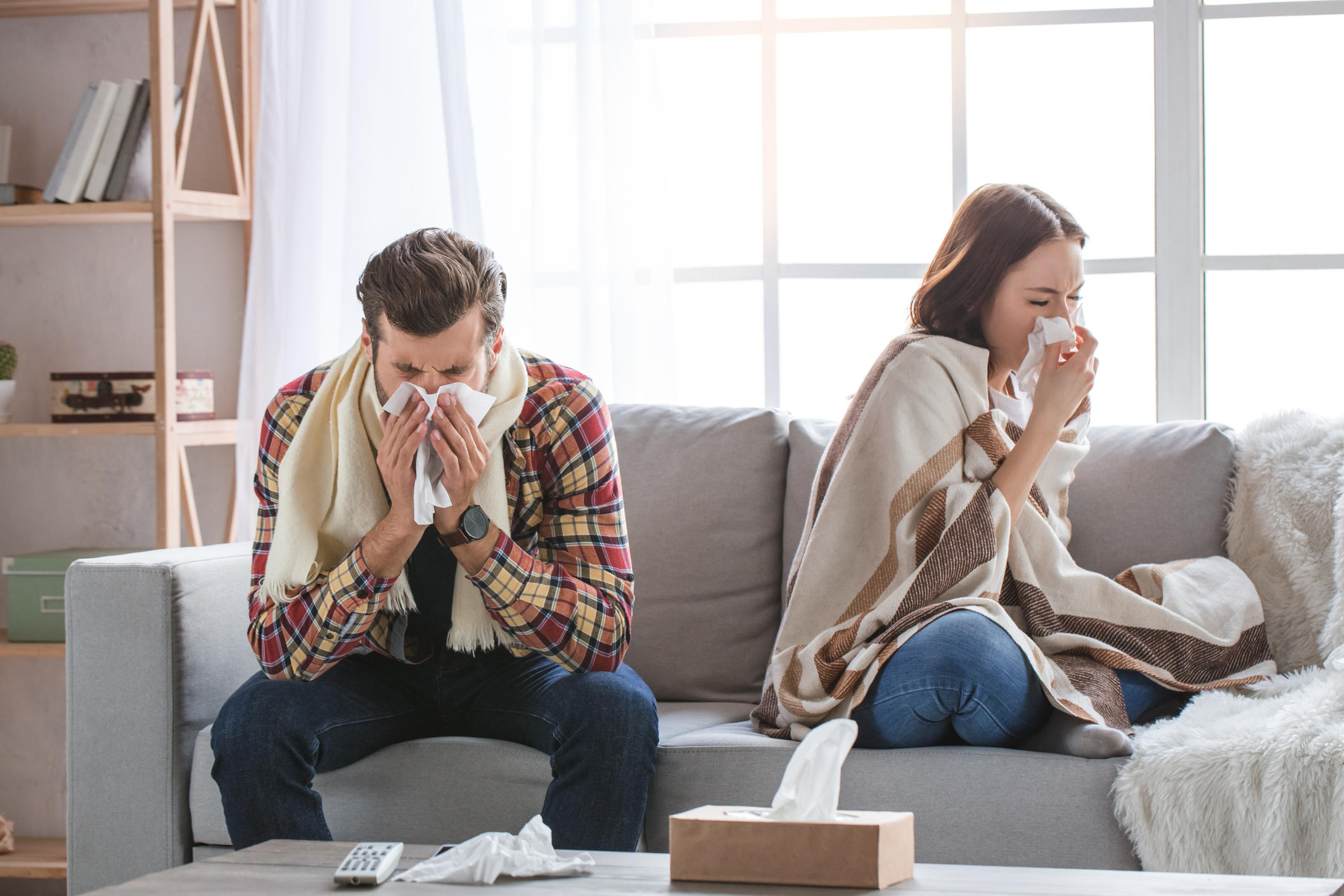 Young woman and man family couple indoors sick
