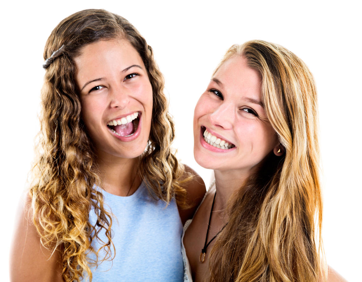 Two extremely pretty, smiling young women look delighted in this double, head and shoulders portrait.