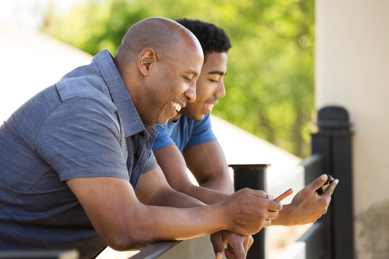 Father talking and spending time with his teenage son.