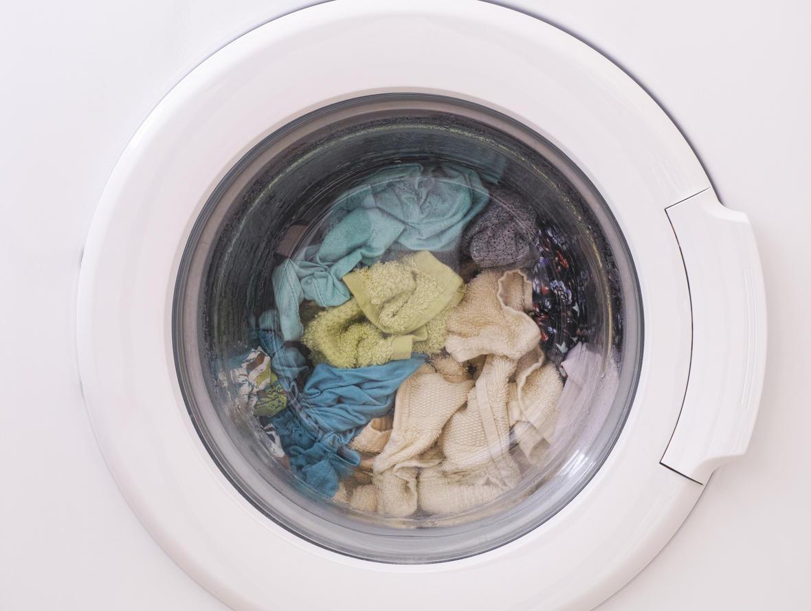 Full loaded washing machine. Close up.