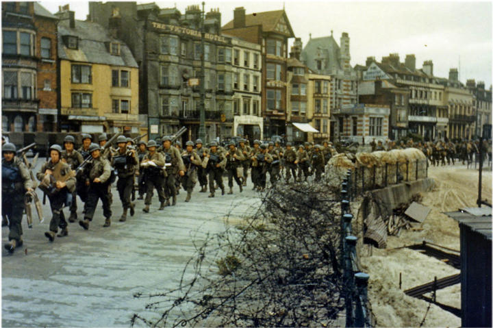 American troops marching through the streets of Weymouth on their way to the docks where they will be loaded into landing craft for the big assault.