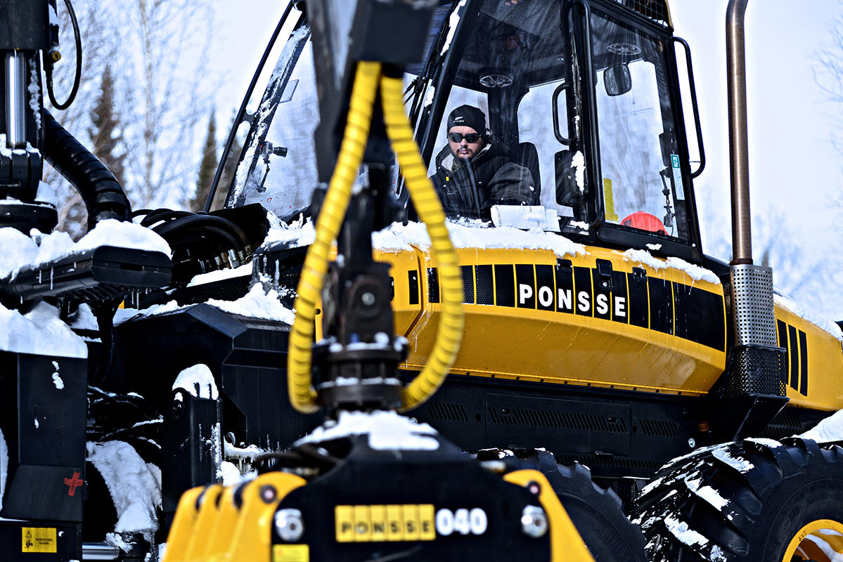 Josiah Heiser in the forwarder. Forwarders are used to move logs from the location where they are cut.