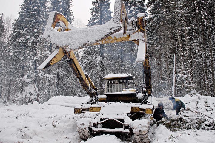 A Russian log loader in the snow.