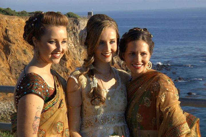 The bride's attendants wore saris instead of bridesmaid dresses.