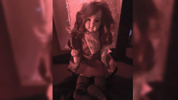 A Doll So Haunted Her Owner Wears A Hazmat Suit To Move Her The