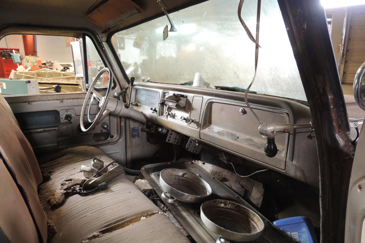 A view of the Chevy pickup interior through the driver's side door.