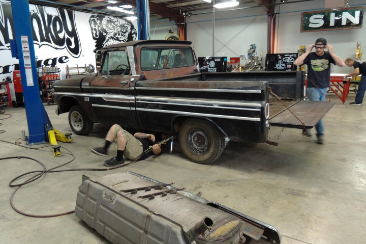 Keenan, Hons and Dustin DeLeon work on the 1965 Chevy C-10 pickup truck.