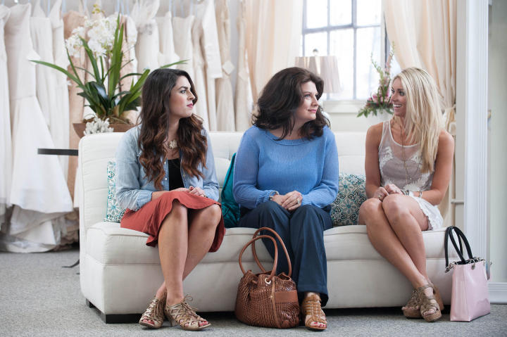 Bride Danielle brought her future mother-in-law and sister-in-law to Heidi's salon to help her choose a wedding dress.