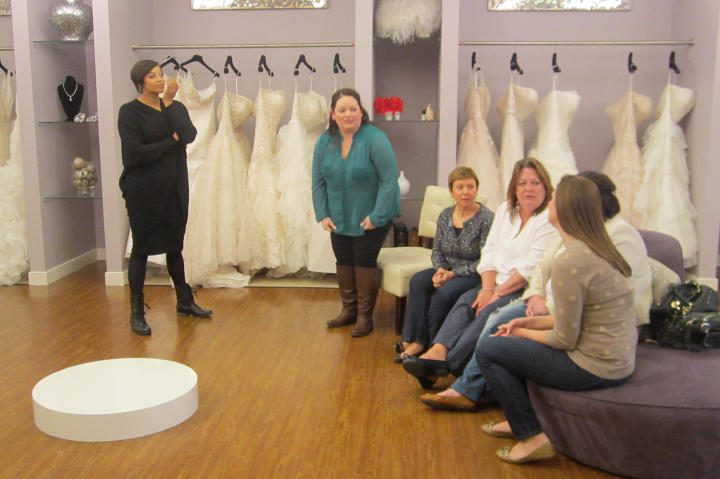 Step into Curvaceous Couture, the bridal salon operated by sisters Yukia and Yuneisia. Here, Yuneisia greets bride Christen and her entourage.
