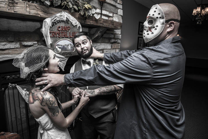 Angi and Matt had a Friday the 13th wedding. They fill the evening with all things that go bump in the night. Here Jason (as in Freddy vs. Jason) gave the couple a deadly scare.