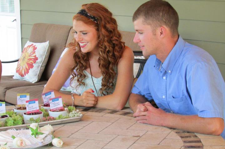 The wedding featured fruit cobbler for dessert. Here, Audrey & Jeremy taste a few different flavors.
