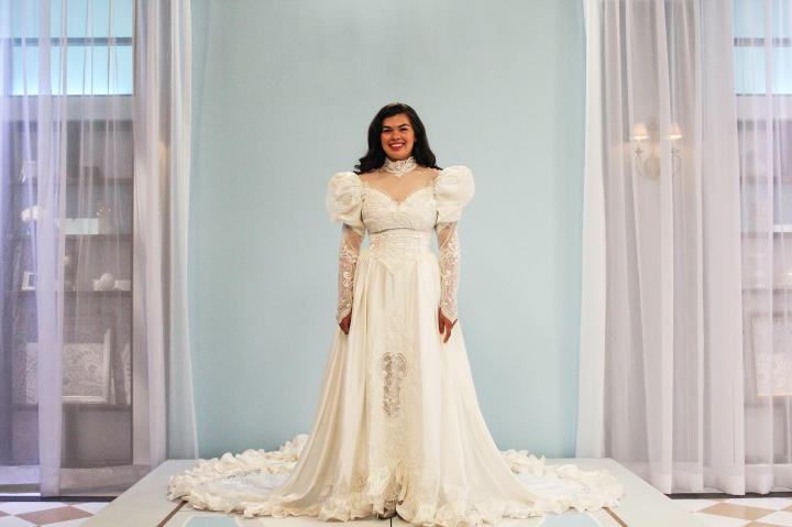 Karlee's borrowed dress was her mother's huge, satin '80s dream gown. With its basque waist, high neck and puffy sleeves, this dress had every outdated trend that Karlee despised. Luckily, the cathedral-length train gave Kelly plenty of fabric to work with!