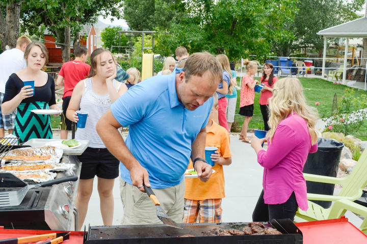 Brady tackles a big job - grill master for his family BBQ.