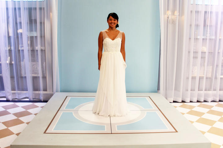 Jaime adored the reworked gown and promised to wear it down the aisle. Kelly gave her a deep V-neck with bead-trimmed illusion straps and a skirt with layers of chiffon for texture and movement. The cost of the makeover was $975.