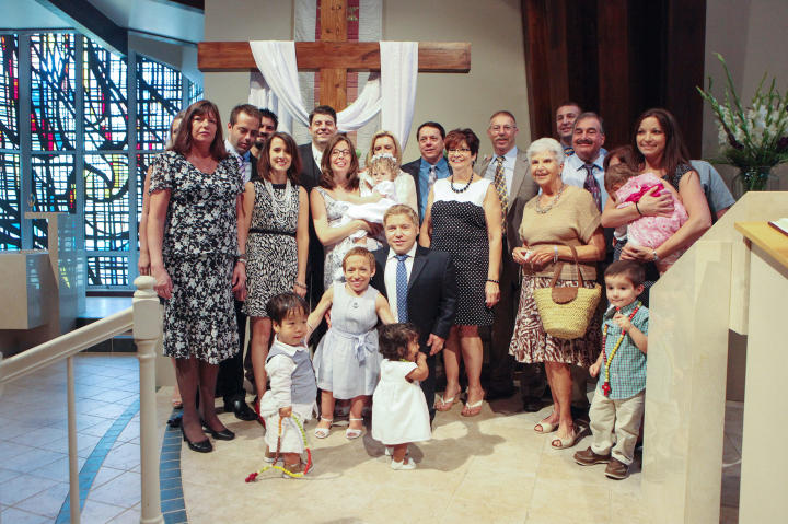 Bill and Jen chose to have the kids' baptism in Florida because Bill's brother and sister-in-law were also baptizing their child. A joint baptism made travel easier on the whole extended family -- and here's everyone, all smiles at the joyous occasion!