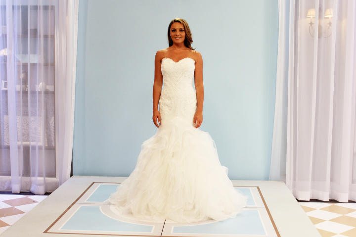 "Alysha's new pick was this Pronovias ""Beca"" design, priced at $2,500. It's a crystal-embellished mermaid silhouette with dramatic organza skirt."