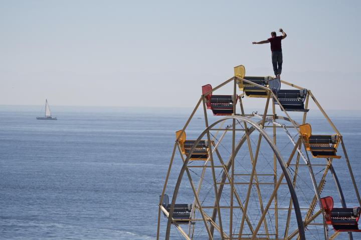 Nik Wallenda practices walking on a Ferris wheel.