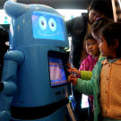 While medical robots are designed to be sterile and efficient, others can exhibit a more human touch. Here, visitors view the Intelligent Service Robot of Shanghai Expo mascot Hai Bao. The robot was designed by Zhejiang University.