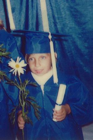 Jen graduating from kindergarten.