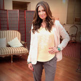 Yellow, even a quieter shade, makes any look pop. Stacy's grey pants a