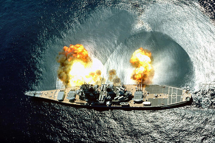 "USS Iowa (BB-61) fires a full broadside of her nine 16""/50 and six 5""/38 guns during a target exercise near Vieques Island, Puerto Rico."