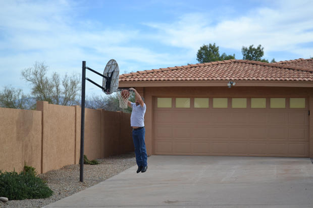 Ed Rosenberg dunks a basketball in front of his newly acquired property.