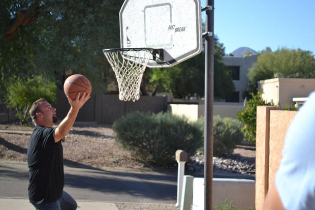 Steve Simons throws some hoops before checking out the inside of a property.