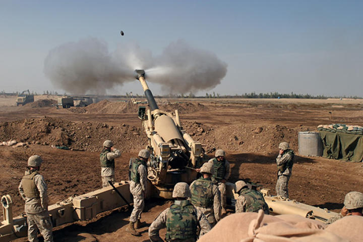 An M-198 155mm Howitzer of the US Marines firing at Fallujah, Iraq, during the Second Battle of Fallujah