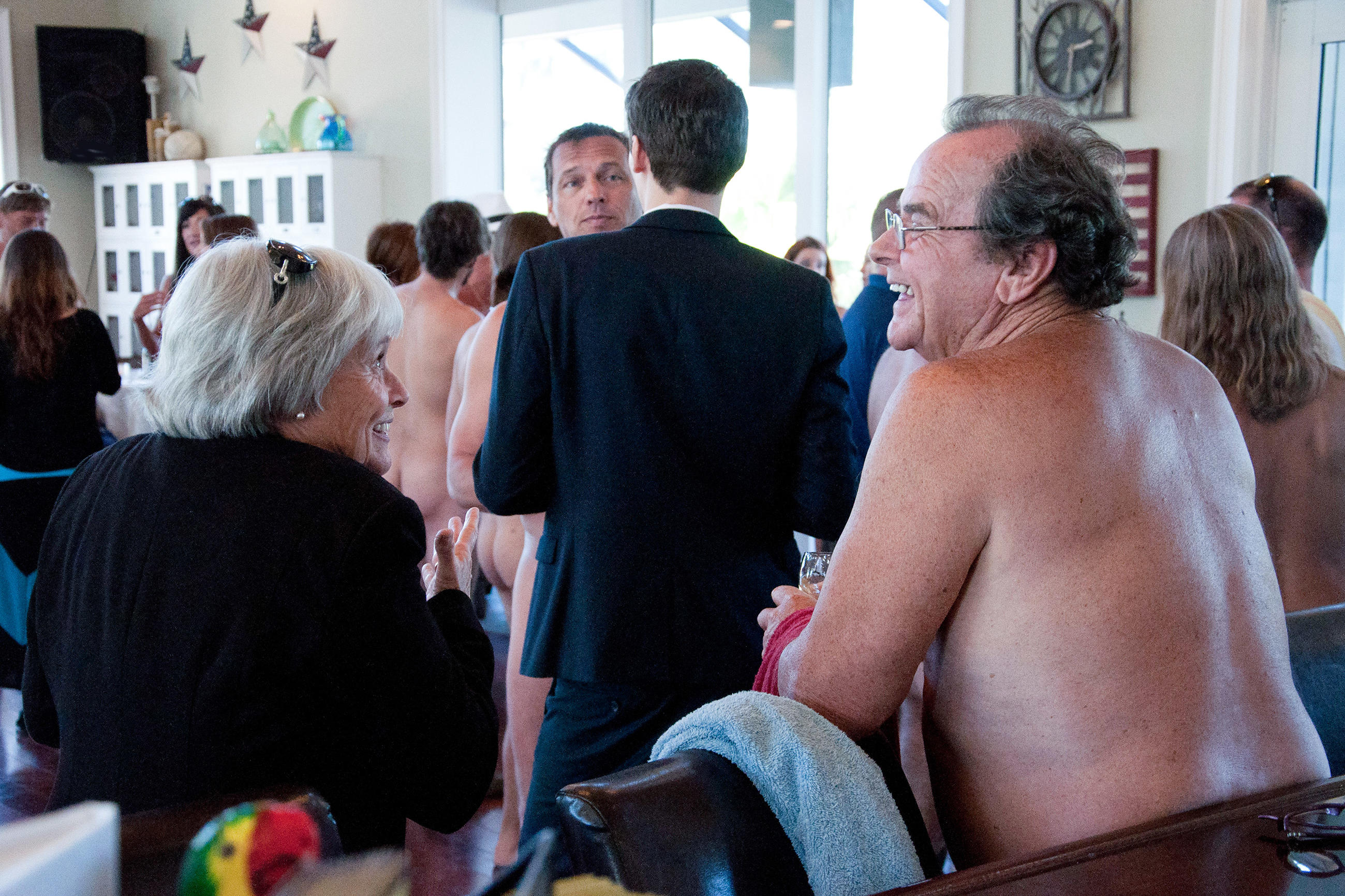 Nudists and textiles chat at the cocktail mixer.
