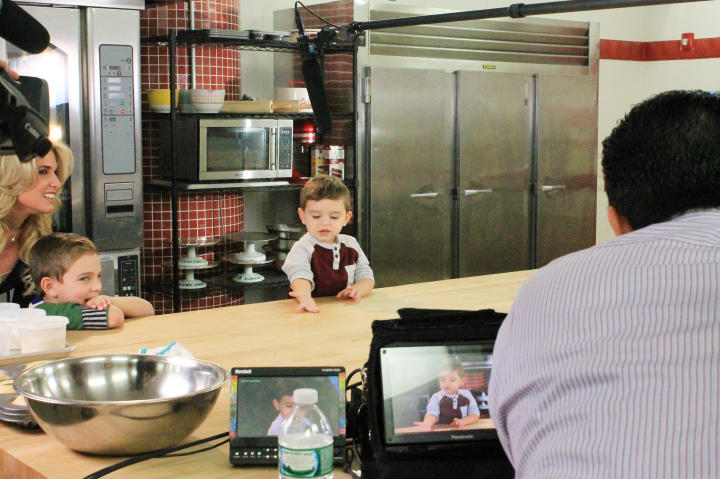 "Carlo gets right to work introducing himself on camera, while proud Dad, ""Cake Boss"" Buddy Valastro, watches."