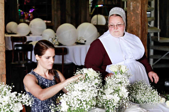 Kate and Mary put the finishing touches on flower arrangements for the wedding.