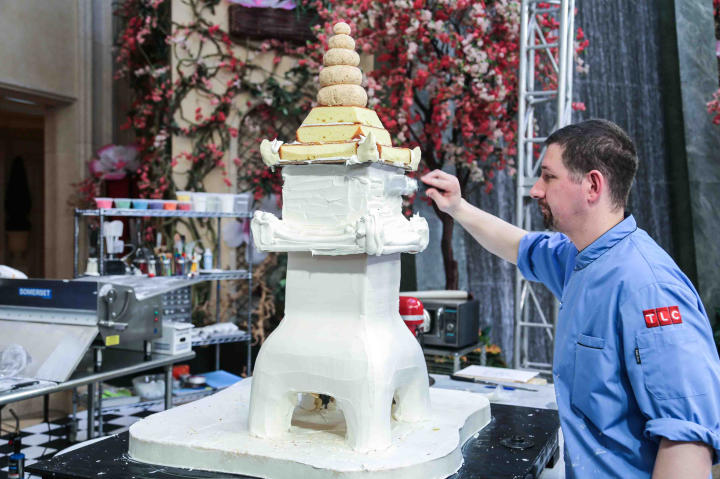 Al is dirty icing (creating a base layer of icing on the cake) the final cake. The team had 12 hours to make a beautiful display cake for Buddy's bakery in Las Vegas.