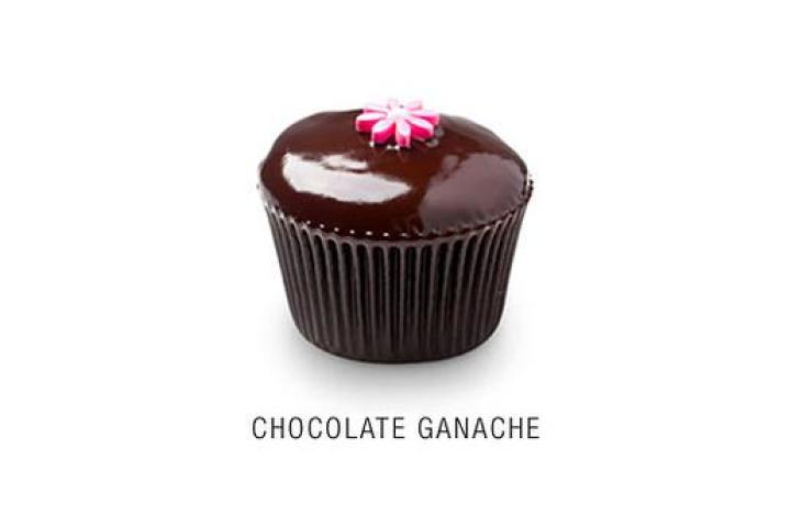 Chocolate Ganache  Valrhona chocolate cupcake with a thin layer of Callebaut chocolate ganache icing topped with a fondant flower.