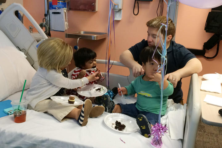 Although Jen is getting chemo, she stays strong for the kids and does her mom duties, like helping Zoey eat a large piece of cake.