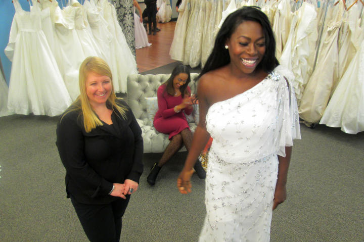 Tohni's reception dress was this one-shoulder beaded gown -- she looked cool and effortlessly chic in the style. The Pronovias design sold for $1,850, but Tohni got it at Vows for only $499. (Not a typo: just $499!)