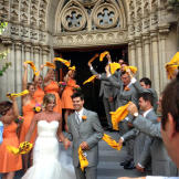 """After the ceremony, the guests stood outside the church waving """"t"""