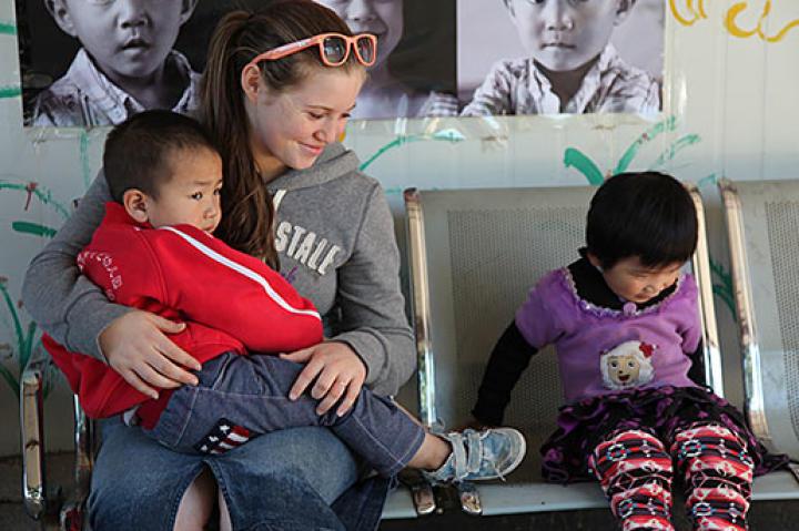 Visiting at an orphanage in China.