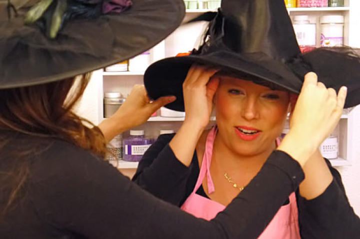 What would a Halloween video be without the proper attire? Katherine adjusts Sophie's witch's hat for the perfect tilt.