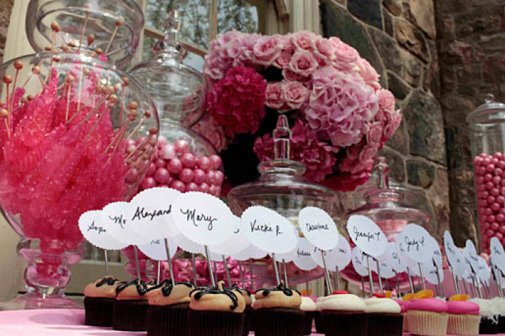 Guests found their way to their seats by matching cupcakes with their names to cupcake table names.