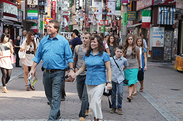 Jim Bob and Michelle lead the way through the streets of Tokyo.