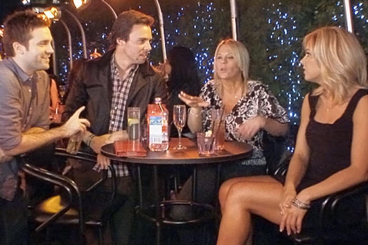Kate (right) and her friend Jamie (second from right) chat with some of the locals at New York City's 230 FIFTH Lounge.